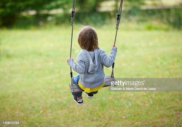 children sitting in swing in backyard - saint ferme stock pictures, royalty-free photos & images