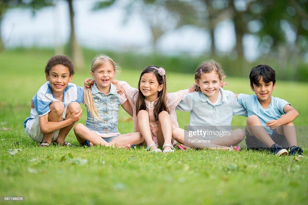 Children Sitting in the Park : Stock Photo