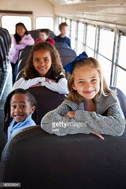 children sitting inside school bus - medium group of people stock pictures, royalty-free photos & images