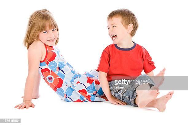los niños riendo estar mientras se distiende en blanco - 6 7 años fotografías e imágenes de stock