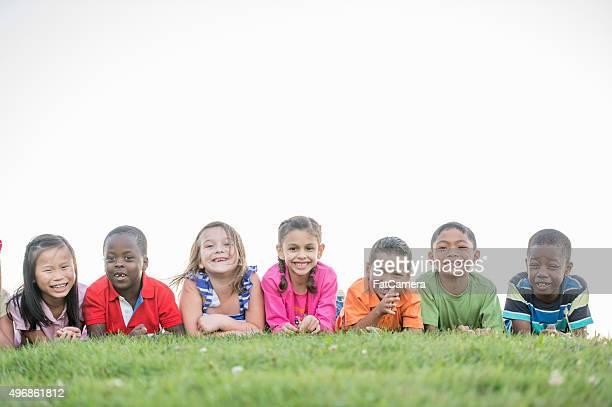 Children Sitting on a Hill