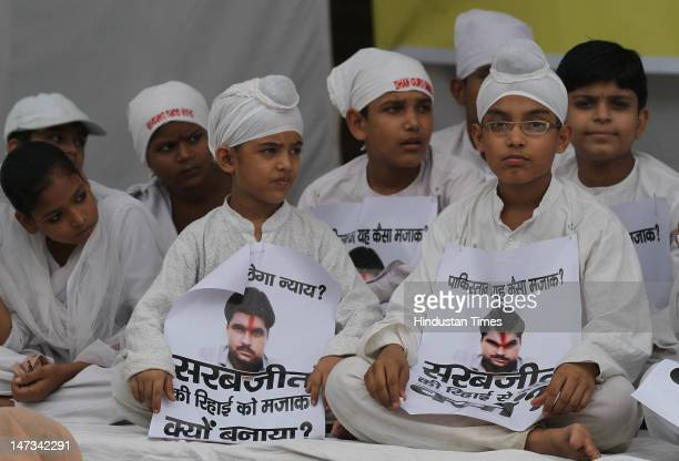 Children sitting on a protest demanding the early release of Sarabjit Singh an Indian prisoner on death row in Pakistan on terrorism charges on June...