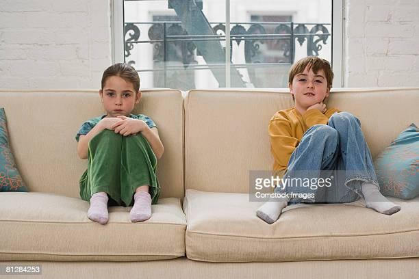 Children sitting on sofa