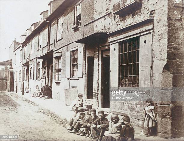 Children sitting on the pavement in New Street Vauxhall circa 1860