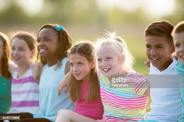 Children Sitting Outside at Recess
