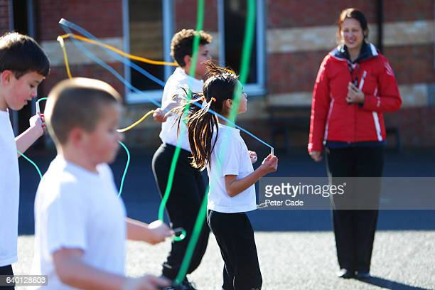 children skipping in playground - physical education stock pictures, royalty-free photos & images