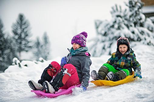 Children sledding in winter. 879714288