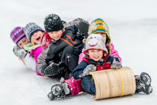 Children Sledding on Toboggan Hill 477639133
