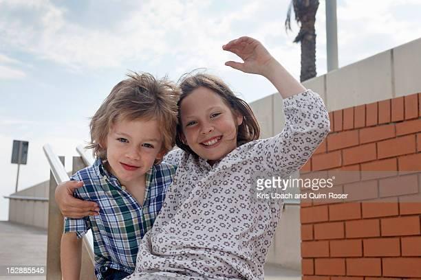 Children sliding down banister on steps