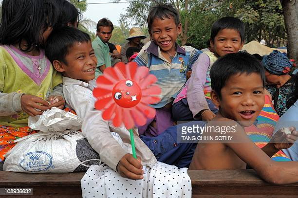 Children smile at a camp after fleeing from their homes near the Preah Vihear temple in Preah Vihear province some 500 kilometers northwest of Phnom...