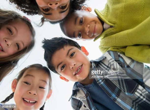 Children smiling in huddle
