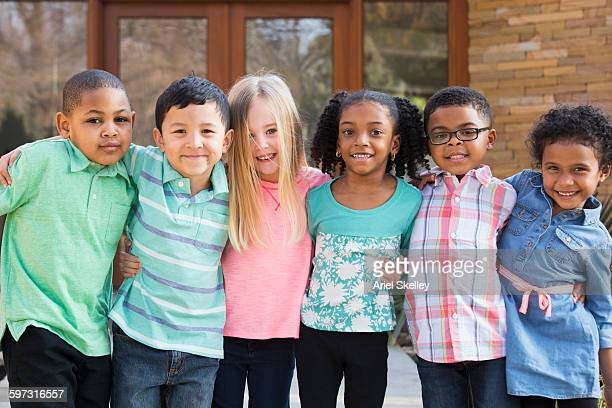 children smiling outdoors - children only photos stock photos and pictures
