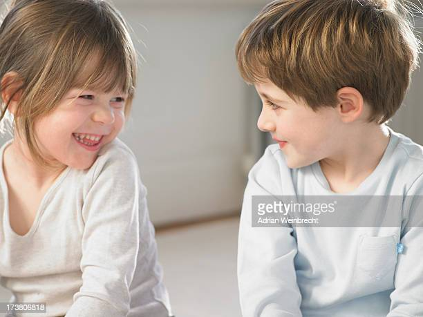 Children smiling together indoors
