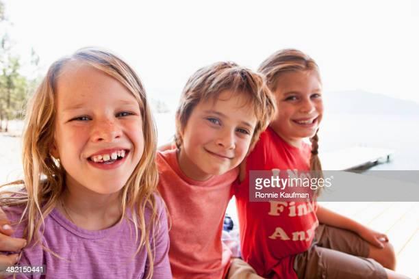Children smiling together outdoors