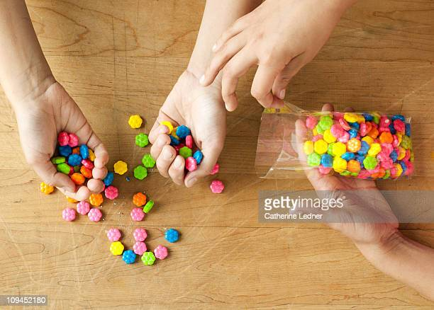 Children sorting candy on a table