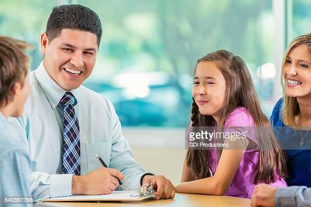 Children speak to businessman