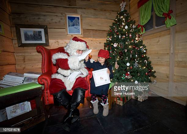 Children speak to santa after being the first to board Santa's Express at Selfridges' Grotto as it opens at Selfridges on November 20 2010 in London...