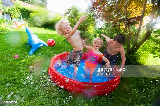 Children splashing in paddling pool