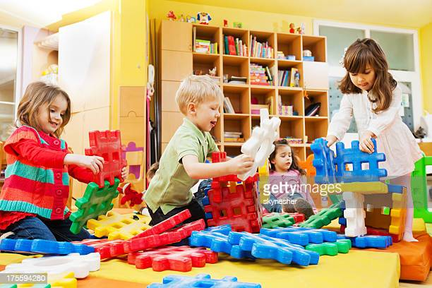 Children stacking blocks.