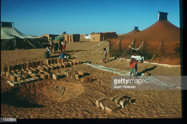 Children stand at the Auserd refugee camp June 18 1997 near Tindouf Algeria Since 1976 Morocco and the Polisario Front have been fighting for...