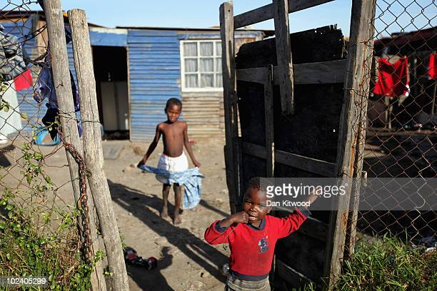 Children stand at the front of their home in the New Brighton Township on June 24, 2010 in Port Elizabeth, South Africa. The New Brighton Township...