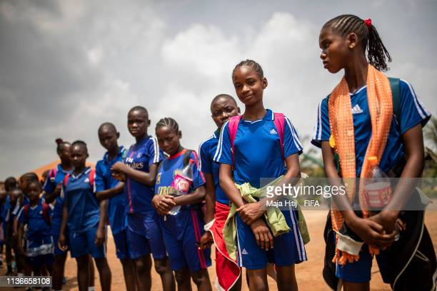 Children stand during FIFA Foundation Community Program visit on March 17, 2019 in Yaounde, Cameroon.