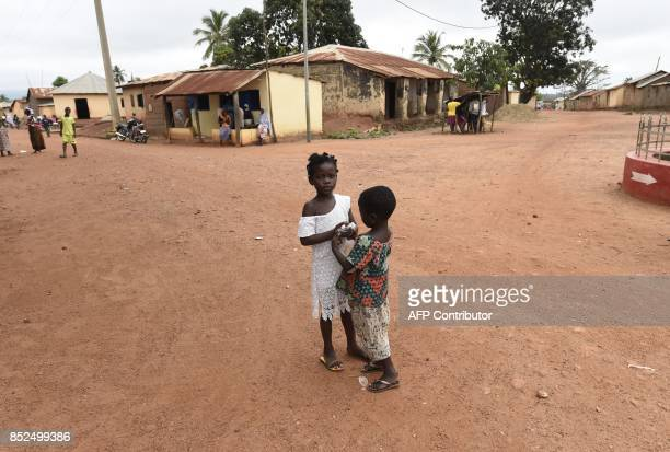Children stand in a deserted street following alleged incessant harassment by the military at Kparatao village near Tchamba in the northern region of...