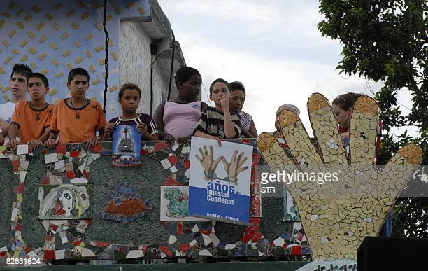 Children stand in a sculpture made in ceramics by Cuban artist Jose Fuster in honour of five Cuban agents jailed for more than ten years in the US...