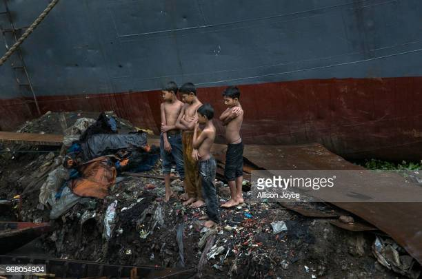 Children stand in the rain in a dockyard on the Buriganga river on June 4 2018 in Dhaka Bangladesh Bangladesh has been reportedly ranked 10th out of...