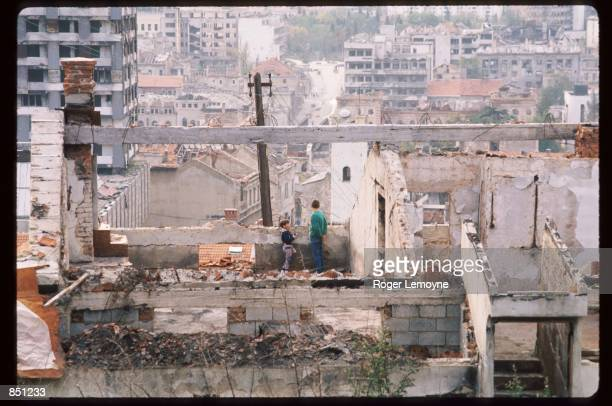 Children stand in the ruins of their home December 1, 1994 in Mostar, Bosnia-Herzegovina. When Bosnia declared its independence in March of 1992, the...
