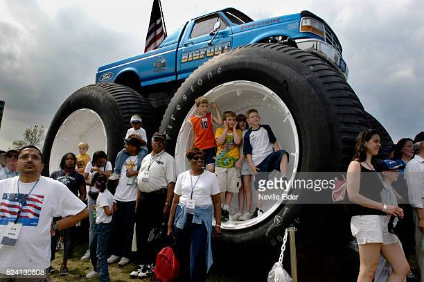Children stand in the wheel wells of Bigfoot 5 Ford's wellknown monster truck at the 100 years of Ford 4day celebration Photo by Neville Elder/Corbis...