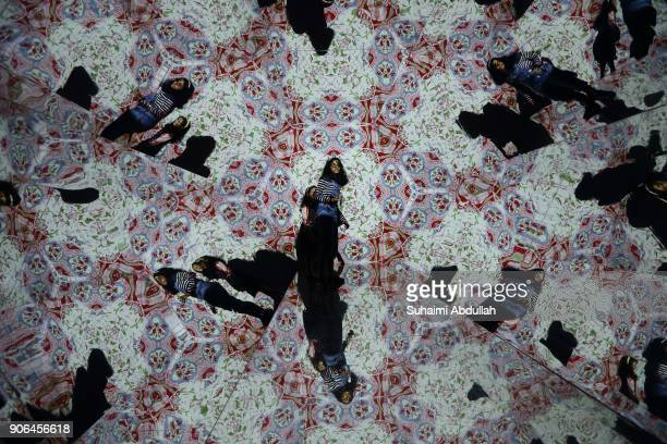 Children stand inside a lifesized kaleidoscope installation titled ÔOH Treasure ChestÕ by Otherhalf Studio during the Light to Night Festival 2018...