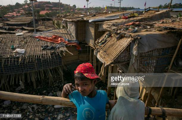 Children stand on a bridge in a Rohingya refugee camp on January 23, 2020 in Cox's Bazar, Bangladesh. On Thursday, the International Court of Justice...