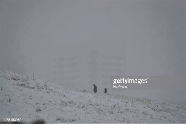 Children stand on a hill during a heavy snowfall in the winter season in Ankara Turkey on January 6 2019
