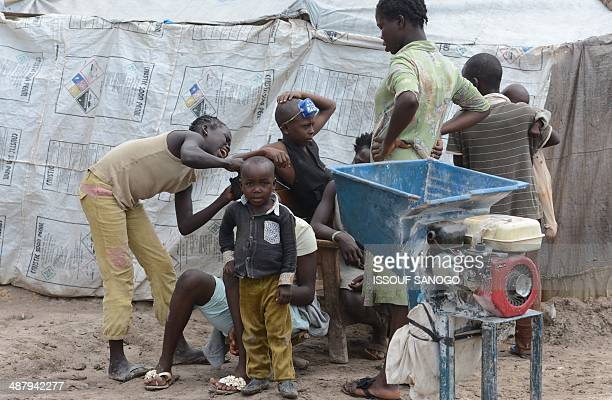 Children stand on May 3 2014 in an IDP camp near Bangui's Mpoko airport where the beginning of the rain season has worsensed the situation of people...