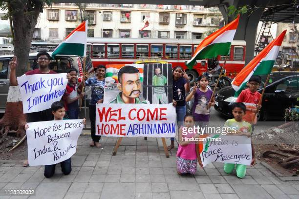 Children stand with a painting of Indian Air Force Wing Commander Abhinandan Varthaman a day before his release from Pakistan at Lalbaug in Dadar on...