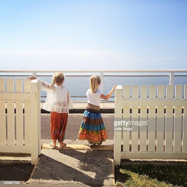 Children standing at gate waiting to cross street