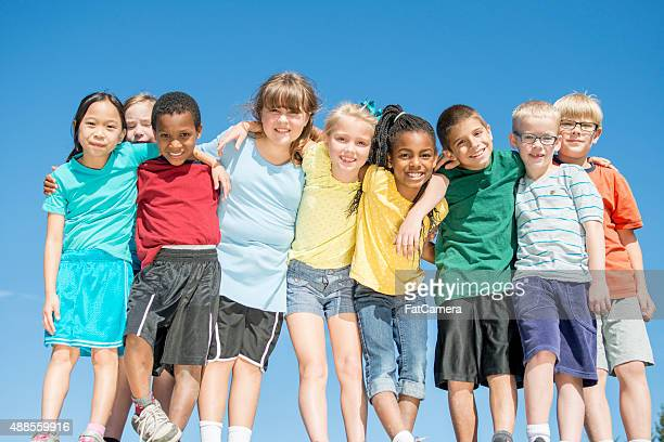 Children Standing Closely Together Outside