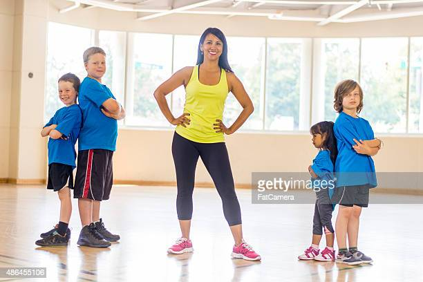 children standing in a gym - sports training camp stock pictures, royalty-free photos & images