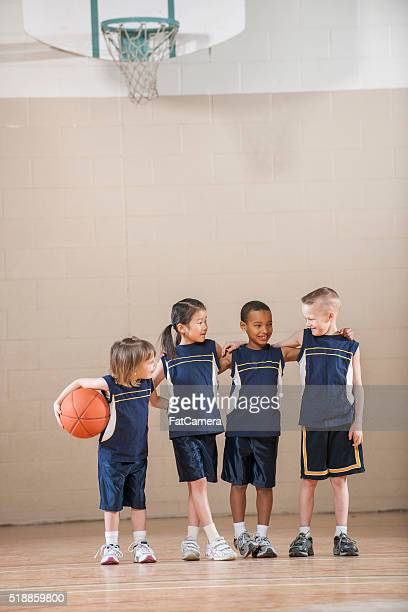Children Standing in a Row Before the Game