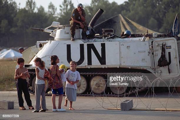 Children Standing near a UN Armored Transport