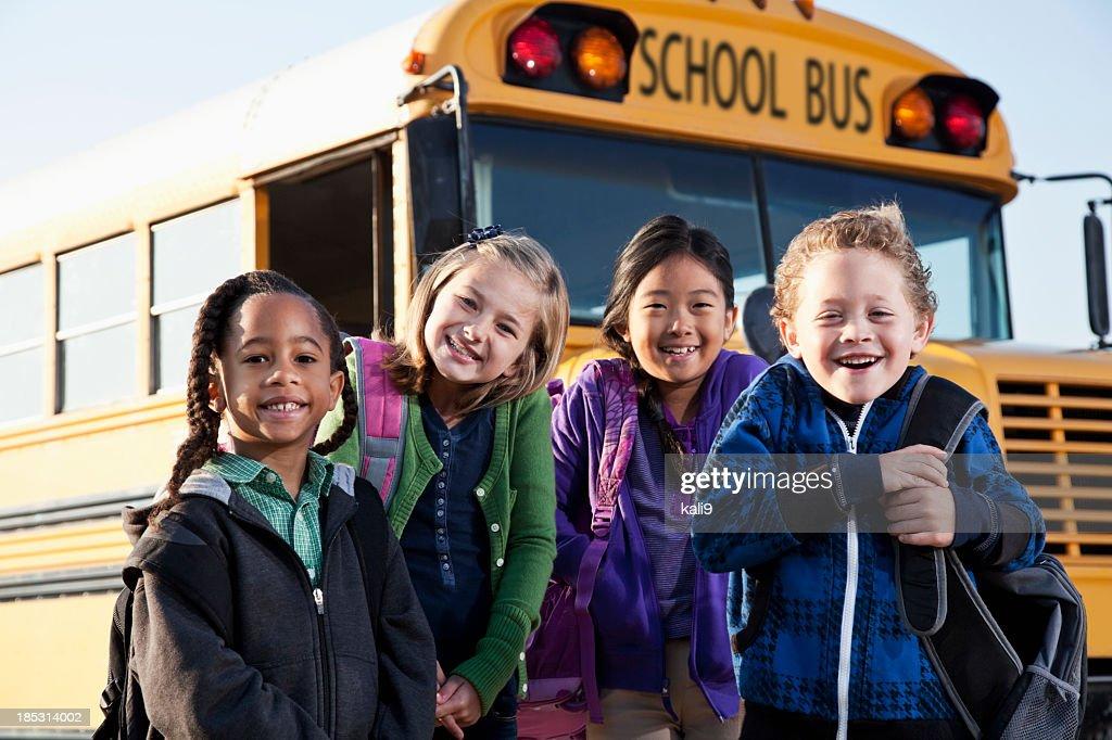Children standing outside school bus : Stock Photo