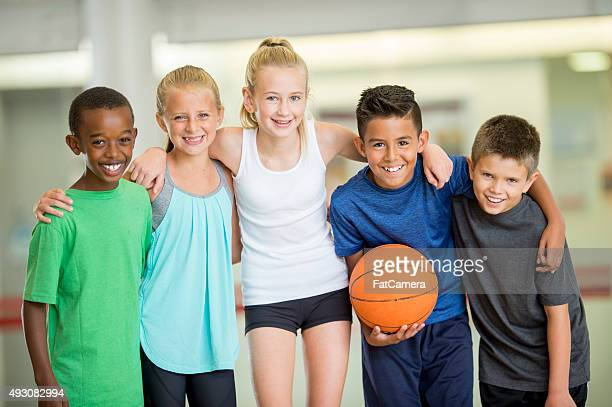 Children Standing Together in the Gym