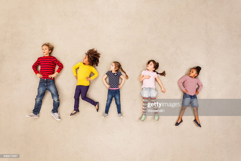 Children standing with hands on hips : Stock Photo