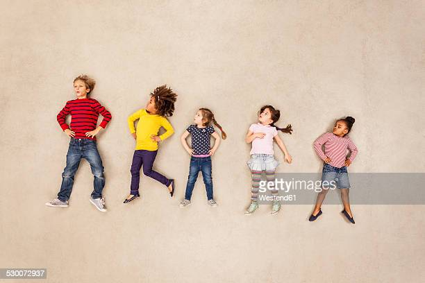 Children standing with hands on hips