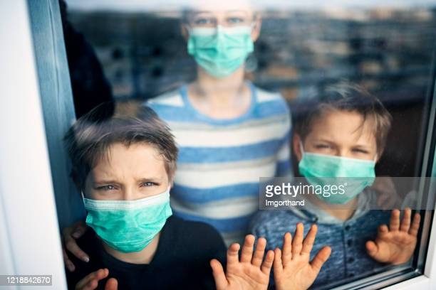 children staying at home during covig-19 pandemic - illness prevention stock pictures, royalty-free photos & images