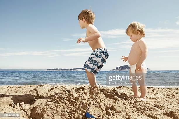 Children stomping on sandcastle