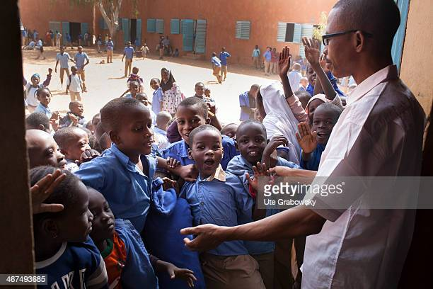 Children storming into a classroom at a Nigerian school on December 09 in Niamey Niger Photo by Ute Grabowsky/Photothek via Getty Images