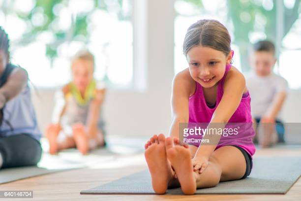 Children Stretching to Their Toes
