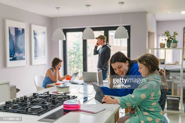 children studying at home whilst parents work from home - two parents stock pictures, royalty-free photos & images
